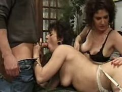 Granny in stockings sucks hard cock in groupsex