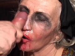 Aged widow in black stockings gets cumload on face