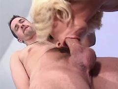 Blonde mature sucks hard cock of dude in bedroom