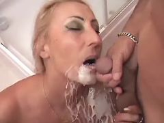 Blonde granny gets hot cumload on face after fuck