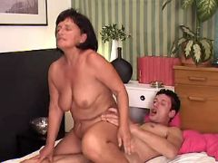 Lusty granny crazy jumps on dick of guy in bed