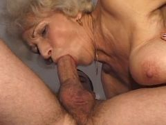 Horny chubby granny deep throats big cock of man