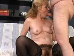 Mature with hairy pussy greedily sucks strong cock