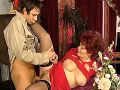Guy fucks redhead granny with big tits on table
