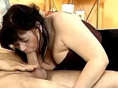 Retired granny greedily throats fresh cock in bed