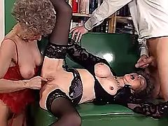 Two aged matures suck cock in orgy