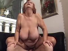 Rednead old lady with massive tits rides hard cock