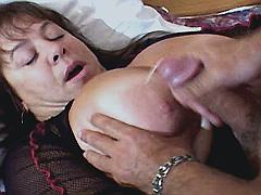 Fat mature gets cumshot on big tits