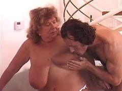 Chubby granny with massive tits spoils man on sofa