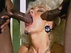 Milf sucking out cum from two cocks