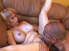 Man licks and fucks chesty blonde mature on sofa