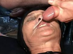 Poor exhausted granny gets cum on face in groupsex