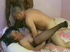 Old lady in stockings fucked by interracial guys